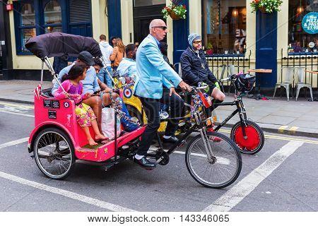 People With Cycle Rickshaws In London, Uk