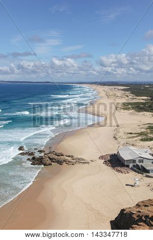 Redhead Beach south of Newcastle is a popular surfing beach. This elevated view shows the beach running down towards Blacksmiths Beach and Swansea.