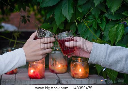 Man and woman clanging glasses with red wine