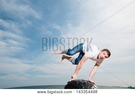 Young Man Jumping On The Beach