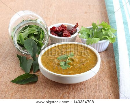 Indian food curry leaves chutney, which is a healthy, vegetarian, traditional and popular side dish for items like chapati, dosa and rice. Curry leaves are said to prevent or help manage diabetes.