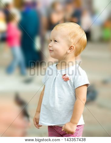 Little cute girl is daydreaming, outdoor shoot