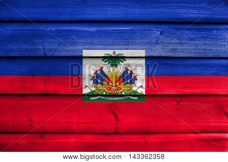 Flag Of Haiti With Coat Of Arms, Painted On Old Wood Plank Background