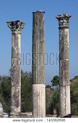 Ruin of ancient corinthian columns in Villa Adriana near Rome, Italy poster