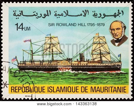 MOSCOW RUSSIA - AUGUST 18 2016: A stamp printed in Mauritania shows old side wheeler on the river series