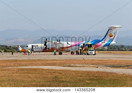 Mae Sot Thailand DEC 20 2014: Unidentified group of people walked to BOMBARDIER Q400 NextGen