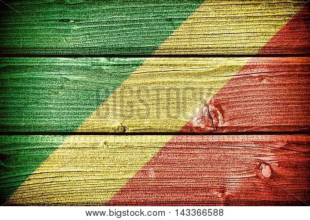 flag of the Republic of Congo painted on old grungy wooden background: 3d illustration