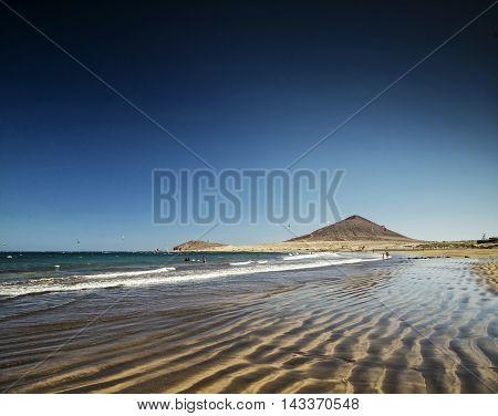 el medano tourist beach and montana roja famous coast landscape in tenerife spain