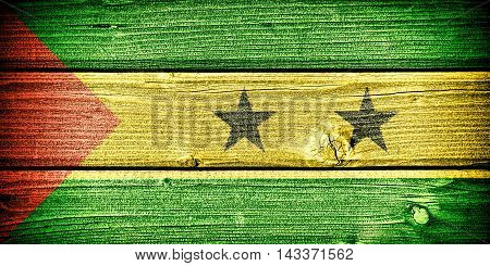 Flag of Sao Tome and Principe painted on old grungy wooden background: 3d illustration