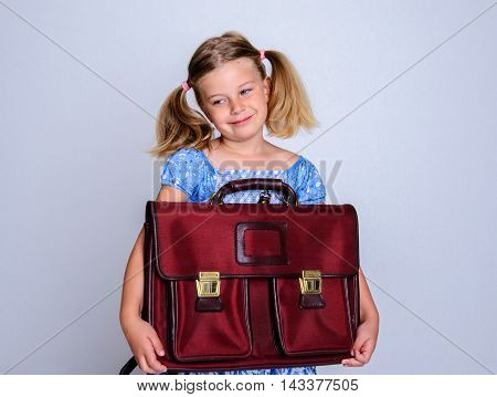 Little Smiling Girl With Old Satchel