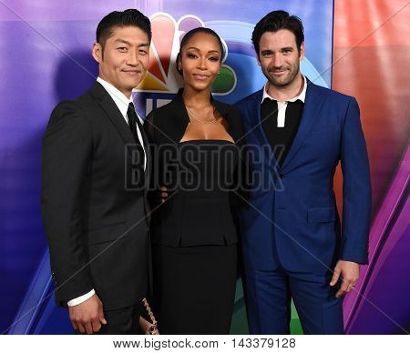 LOS ANGELES - AUG 02:  Brian Tee, YaYa DaCosta & Colin Donnell arrives to the NBC Universal TCA Summer Press Tour 2016 on August 02, 2016 in Beverly Hills, CA