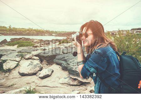 Asia woman taking a photo at Sampanbok natural stone park of Ubonratchathani ThailandFocus on face