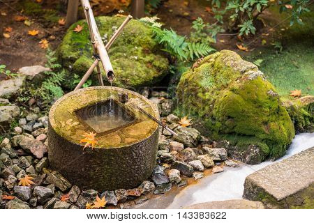 Traditional basin for hand washing in Kyoto, Japan.