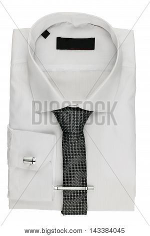 Folded white shirt with a tie and cufflinks isolated on white background