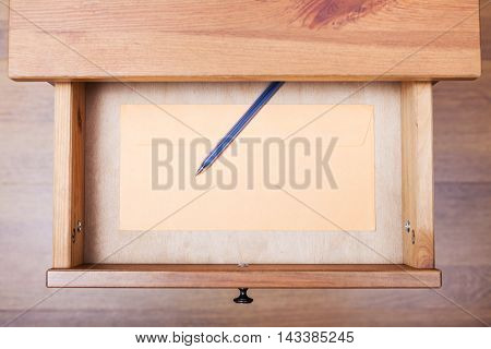 Modern Pen And Envelope In Open Drawer