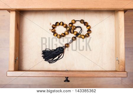 Rosary From Tigers Eye Gemstone In Open Drawer