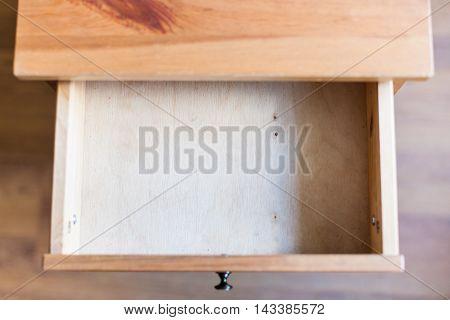 Empty Open Drawer Of Wooden Nightstand