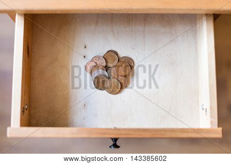 Pile Of British Coins In Open Drawer