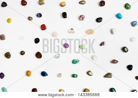 many natural mineral gem stones arranged on white background