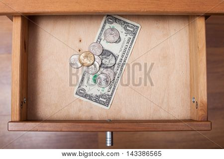 One Us Dollar And Coins In Open Drawer