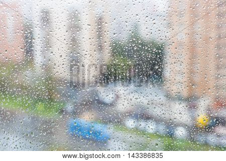 View Of Raindrops On Windowpane Of Urban House