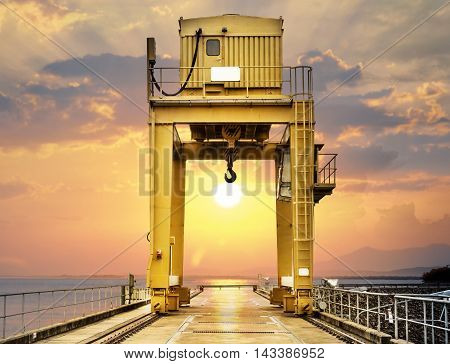 Large Gantry Crane on Sunset at Ubonrat Dam khonkaen Thailand