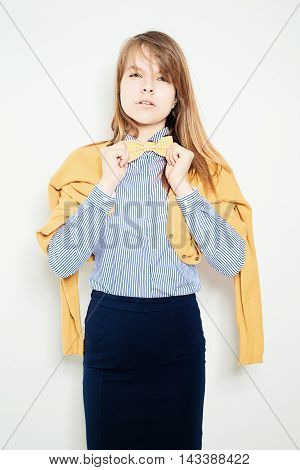 Young Fashion Woman. Yellow Bow Tie Blue Striped Shirt