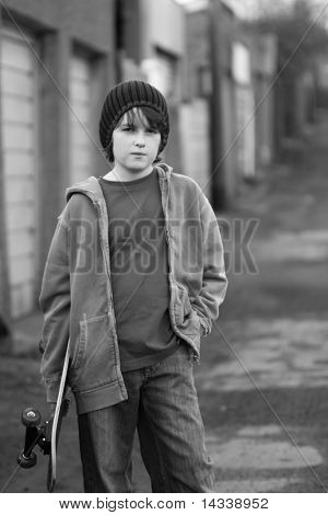 Moody skateboarder in an alleyway, black and white