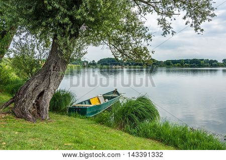 Old boat on the mantova lake during the day