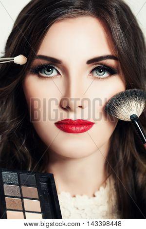 Beautiful Woman with Makeup. Face Closeup. Makeup Concept