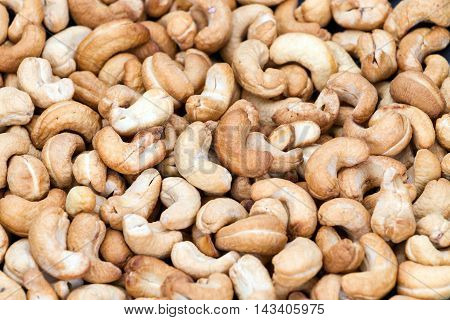 Roasted cashew nuts on top view for background