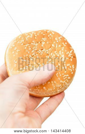 Close-up Image Of A Human Hand With Tasty Hamburger Over The Whi