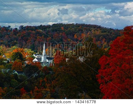 Church steeple with fall colors in Augusta, Maine
