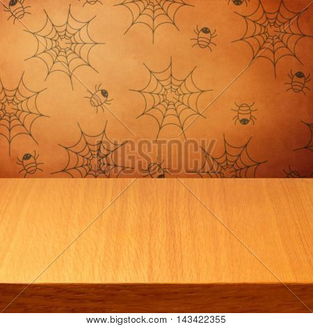 Halloween holiday background with empty wooden table and wallpaper with spiders