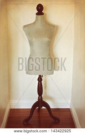 Antique dress form mannequin for model placement