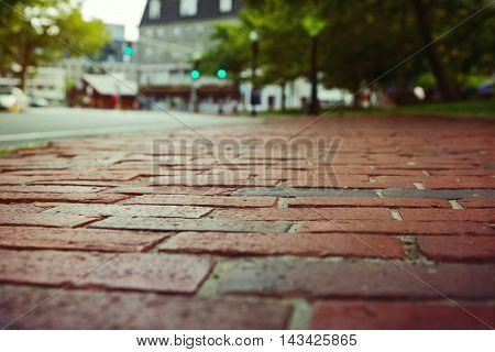 Red brick pavement in Boston Massachusetts USA. Selective focus