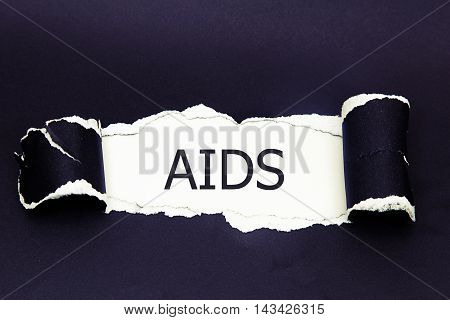 aids written under torn paper.Business, technology, internet concept.