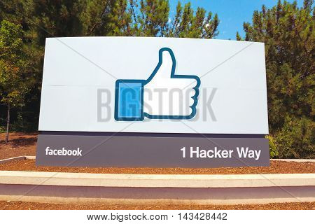 MENLO PARK CA - JULY 17: A sign at the entrance to the Facebook World Headquarters located in Menlo Park California on July 17 2014. Facebook is a popular online social networking service