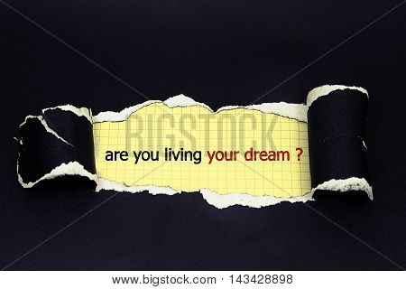 are you living your dream written under torn paper