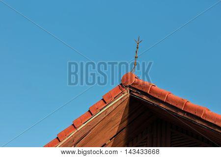 Lightning rod in blue sky background .