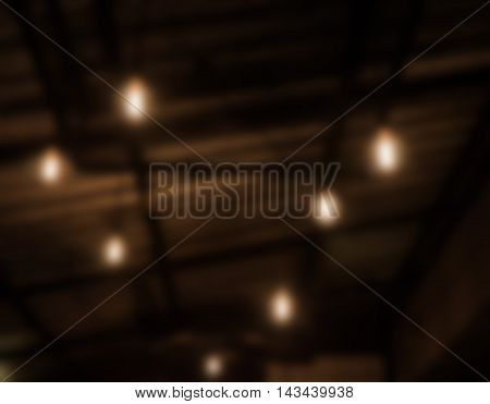Warm lighting lamps on ceiling in coffee shop, stock photo