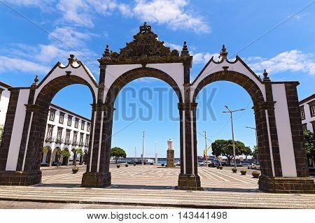 Portas da Cidade gates in Ponta Delgada the capital of Azores Portugal. Town square with the historical entrance overlooking the ocean.