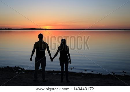 Silhouette of a Couple Walking on the Beach