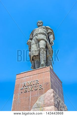 SHAKHRISABZ UZBEKISTAN - MAY 2 2015: The monument to the Turco-Mongol conqueror Amir Temur in the city of his birthplace on May 2 in Shakhrisabz.
