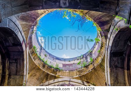 DILIJAN ARMENIA - MAY 31 2016: The hole in dome of the St Grigor Church of Jukhtak Vank Monastery with the blue sky in it on May 31 in Dilijan.
