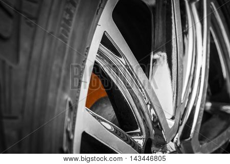 Red-hot brake disc wheel sports car closeup