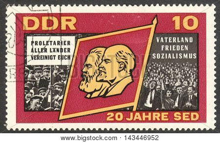 MOSCOW RUSSIA - CIRCA JULY 2016: a stamp printed in DDR shows Flag with Marx and Lenin the series