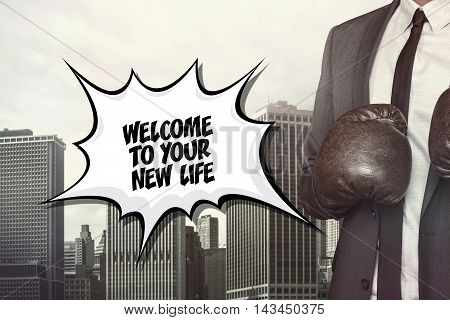 Welcome to your text on speech bubble with businessman wearing boxing gloves