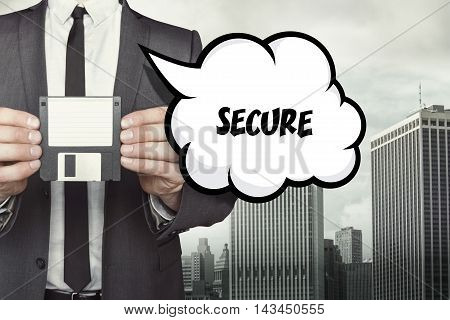 Secure text on speech bubble with businessman holding diskette