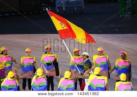 RIO DE JANEIRO, BRAZIL - AUGUST 5, 2016: Tennis player Rafael Nadal carrying the Spanish flag leading the Spanish Olympic team in the Rio 2016 Opening Ceremony at Maracana Stadium in Rio de Janeiro